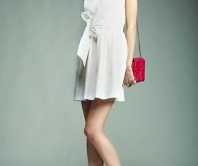 Fashion beautiful girl holding red handbag Stock Photo 01