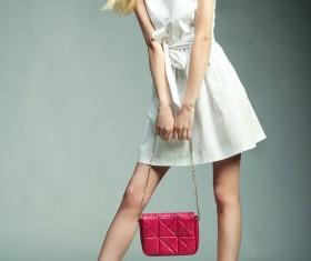 Fashion beautiful girl holding red handbag Stock Photo 02
