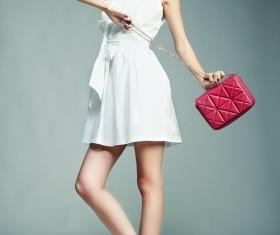 Fashion beautiful girl holding red handbag Stock Photo 03