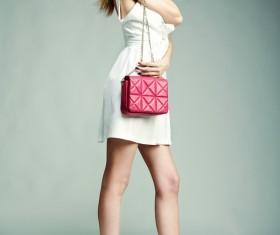 Fashion beautiful girl holding red handbag Stock Photo 05