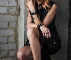 Fashion girl squatting to take pictures Stock Photo