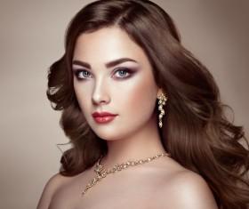 Fashion makeup girl wearing jewelry Stock Photo