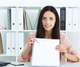 Female holding record book and pen Stock Photo