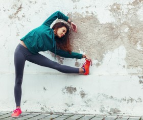 Girl doing stretching exercise Stock Photo