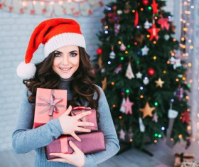 Girl receiving Christmas present Stock Photo 03