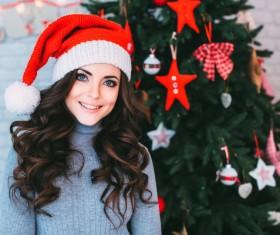 Girl wearing Christmas hats Stock Photo