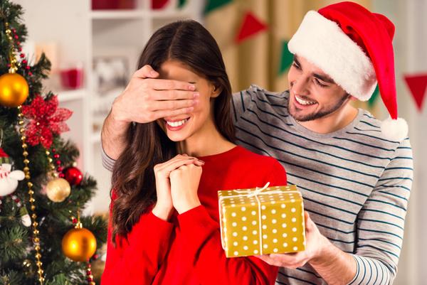 Give girlfriend Christmas present Stock Photo - Christmas stock photo free download