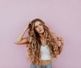 Golden long curly hair girl Stock Photo