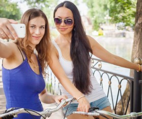 Good friends taking photos with smartphones Stock Photo