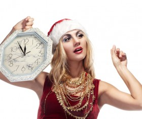 Hand holding the clock waiting for Christmas Eve Stock Photo