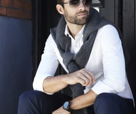 Handsome fashion man sitting on the steps Stock Photo