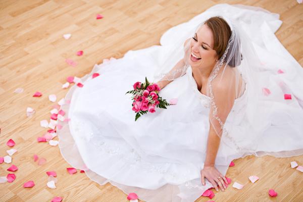 Happy bride sitting on the floor Stock Photo