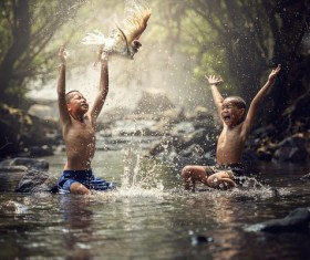 Happy children playing in the creek Stock Photo