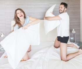 Happy couple pillow fight Stock Photo 01