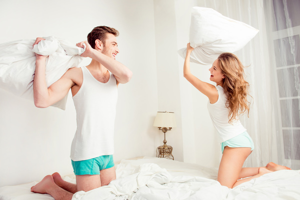 Happy couple pillow fight Stock Photo 02