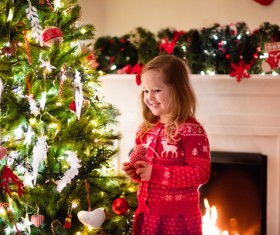 Happy little girl decorated Christmas tree Stock Photo 06