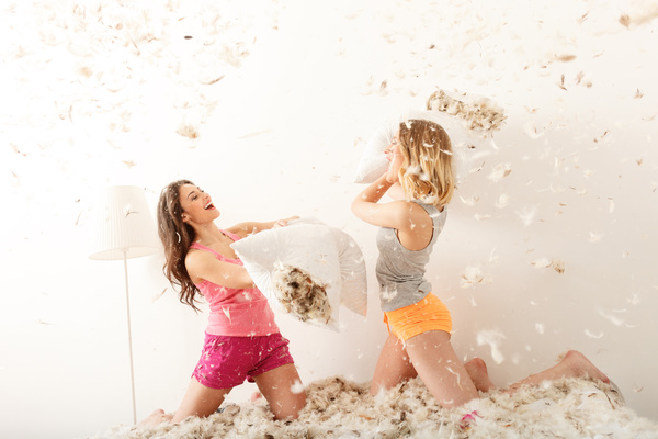 Happy sisters pillow fight Stock Photo 01