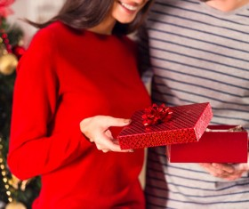 Happy woman opening Christmas gift Stock Photo 02
