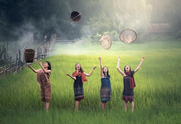 Happy women in the field Stock Photo