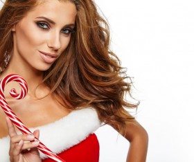 Hold Christmas candy girl Stock Photo