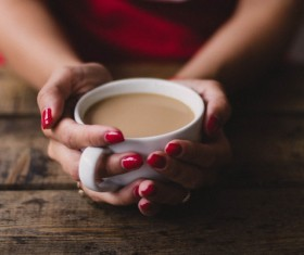 Holding a cup of tea close-up Stock Photo