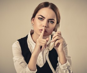 Hush I answer the phone Stock Photo