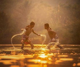 In the small river practicing Muay Thai boy Stock Photo 01