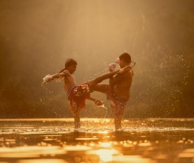 In the small river practicing Muay Thai boy Stock Photo 02