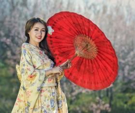 Japanese girl wearing kimono hold red umbrella Stock Photo