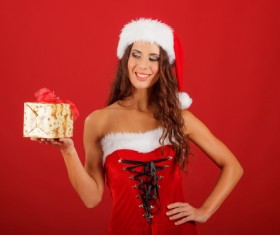 Lady wearing christmas costume holds gift box Stock Photo 01