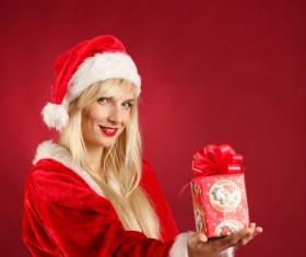 Lady wearing christmas costume holds gift box Stock Photo 03