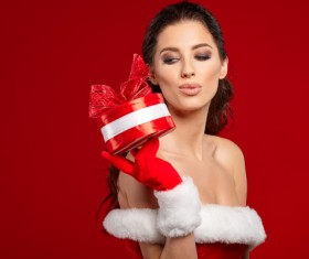 Lady wearing christmas costume holds gift box Stock Photo 04