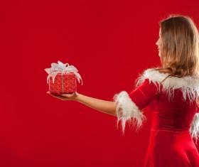 Lady wearing christmas costume holds gift box Stock Photo 05