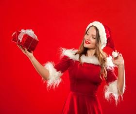 Lady wearing christmas costume holds gift box Stock Photo 06