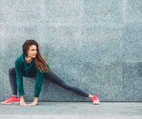 Legs stretching exercise for girl Stock Photo 01