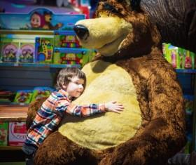 Little boy hugging teddy bear Stock Photo