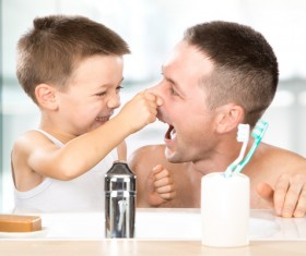 Little boy pinching fathers nose Stock Photo
