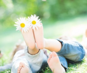 Little feet and flowers Stock Photo