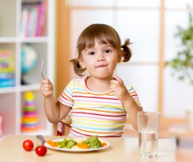 Little girl having lunch Stock Photo