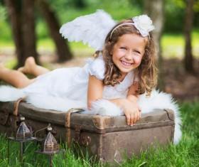 Little girl lying on the suitcase Stock Photo