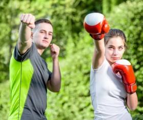 Male coach teaching girl to boxing Stock Photo