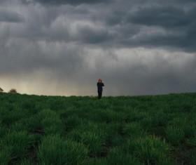 Man and alpine cloudscape photo Stock Photo