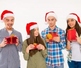 Man and girl holding Christmas present Stock Photo