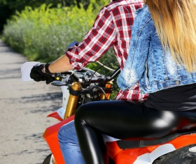 Men and women riding motorcycle Stock Photo