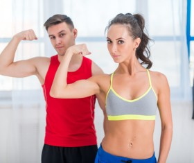 Men and women show biceps Stock Photo