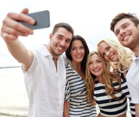 Men and women taking photos with smartphones Stock Photo 01