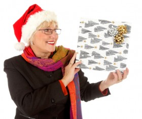 Middle aged woman holding Christmas present Stock Photo