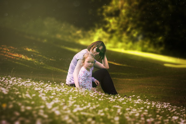 Mother playing with her daughter outdoors Stock Photo