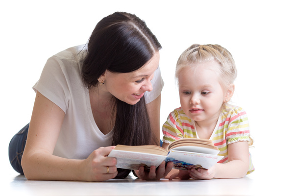 Mother reading to her daughter Stock Photo