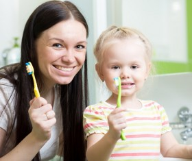 Mother teaching daughter brush teeth Stock Photo 01